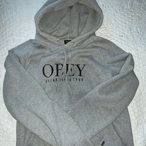 Gray Obey hoodie with logo on the front